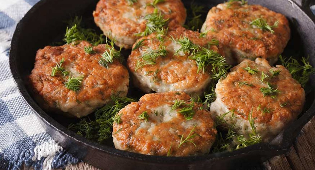 stock-photo-delicious-fish-cakes-with-dill-closeup-in-a-pan-on-the-table-horizontal-347993891